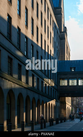 Late afternoon sunlight on the Town Hall Extension building and footbridge, Lloyd Street, Manchester, England, UK - Stock Image