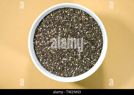 Bowl of Healthy Dry Natural Chia Seeds - Stock Image