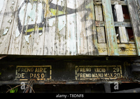 Detail of wood car train with stop brake signs at the abandoned Canfranc International railway station (Canfranc, Pyrenees, Huesca, Aragon, Spain) - Stock Image