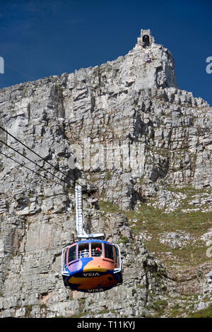 A gondola on the cableway that carries passengers to the top of Table Mountain, the flat-topped mountain that's a prominent landmark overlooking Cape  - Stock Image