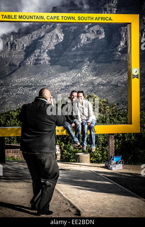 A couple being photographed in one of the six Table Mountain Frames, (this one is on Signal Hill) in Cape Town, - Stock Image
