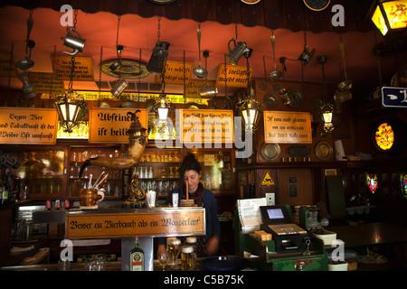 Frankfurt german waitress at bar with beers at iconic historic beer bar kneipe City Hall Rathausplatz - Stock Image