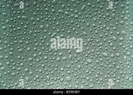 Raindrops on glass. Cyan - Stock Image
