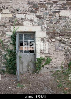 Old disused door in France, Loire region. - Stock Image