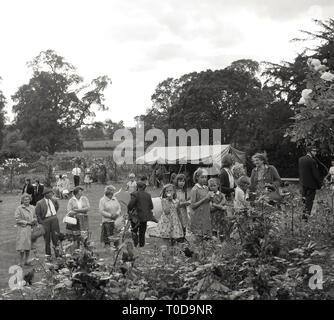 1967, people at a garden fete, Buckinghamshire, England, UK. - Stock Image
