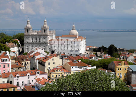 A view over the rooftops of buildings in Alfama towards the Church of Sao Vicente of Fora in Lisbon Portugal Europe EU  KATHY DEWITT - Stock Image