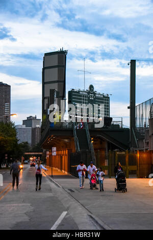 Family walking around Wrigley Field, Wrigleyville, Chicago. Wrigley Field is a baseball park located on the North - Stock Image