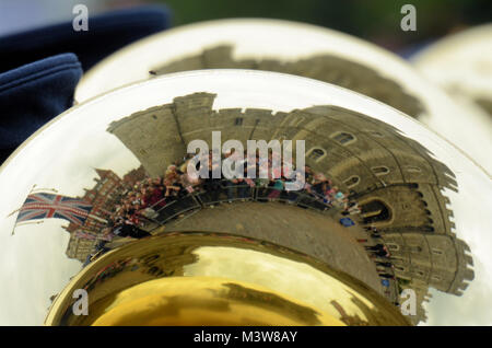 Windsor Castle and people reflected in a brass instrument of a marching band celebrating Queen Elizabeth's Diamond - Stock Image