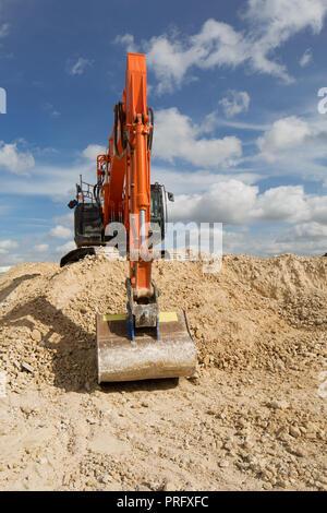 Excavator digger on building construction site. UK. unsharpened - Stock Image