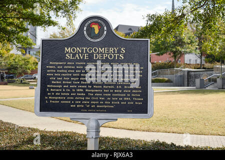 Historical marker describing the depots or warehouses used in the 1800's during the height of the slave trade in Montgomery, Alabama USA. - Stock Image