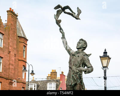 Dunbar, East Lothian, Scotland, UK. 21st Apr 2019.  John Muir's 181st birthday in his birthplace. A statue of John Muir as a boy by Valetin Znoba in the centre of the town - Stock Image
