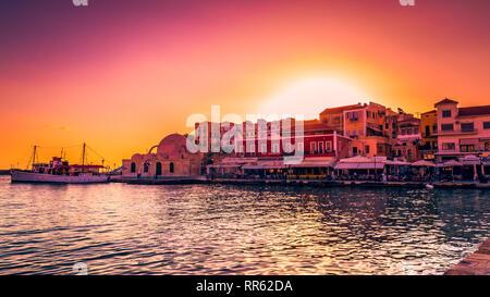 CHANIA, CRETE ISLAND, GREECE - JUNE 26, 2016: Stunning sunset view of the old venetian port of Chania on Crete island, Greece. - Stock Image