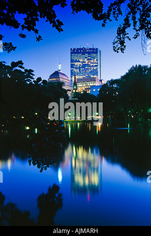 Twilight view of Back Bay buildings seen from the lagoon in the Boston Public Garden Boston Massachusetts - Stock Image