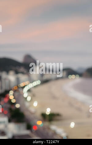 Deliberately defocused aerial view of Copacabana Beach and Sugarloaf Mountain in Rio de Janeiro, Brazil. - Stock Image