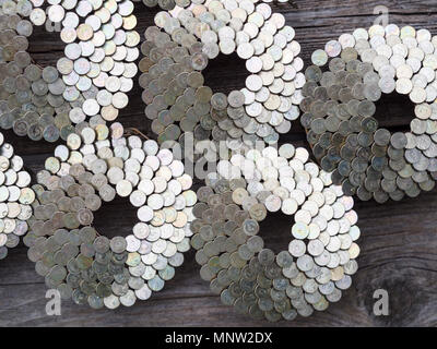 Clusters of Bright Roofer's Nails: Round clusters of bright silver roofer's nails make an interesting pattern. - Stock Image