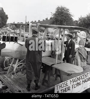 1960s, historical, people dressed up on a float, 'Those Magnificient Men and their Flying machines', at the Bierton festival or carnival, England, UK. - Stock Image