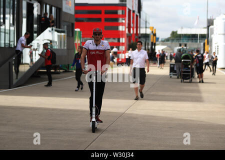 Silverstone, Northampton, UK. 11th July 2019. F1 Grand Prix of Great Britain, Driver arrivals day; Alfa Romeo Racing, Antonio Giovinazzi Credit: Action Plus Sports Images/Alamy Live News - Stock Image