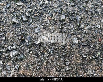 full frame image of wet concrete / asphalt texture surface for background - Stock Image