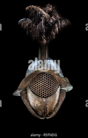 Gladiator helmet 	adorned with ostrich feathers. Ancient roman gladiator reconstruction. Isolated over black - Stock Image