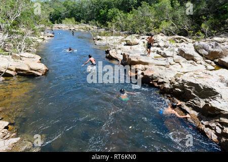 Aboriginal children swimming and having fun in the Annan River near Cooktown, Far North Queensland, QLD, FNQ, Australia - Stock Image