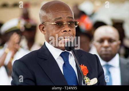 Abidjan, Cote d'Ivoire - August 3, 2017: Congratulatory address to end-cycle extenders of the representative of the sponsor of the ceremony the Presid - Stock Image