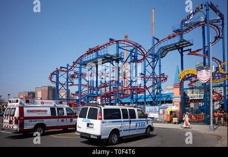 New York, USA - July 02, 2018: An ambulance and NYPD vehicle parked in front of Coney Island amusement park. - Stock Image