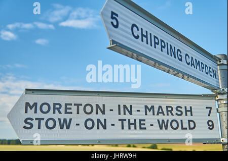 Road sign in the Cotswolds with iconic tourist towns named. - Stock Image