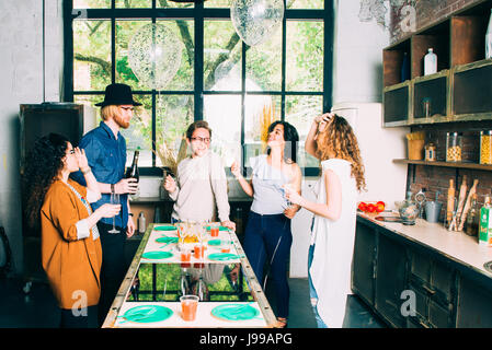 Group of young friends celebrate  a birthday on an open space - Stock Image