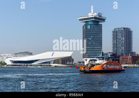 Waterfront of Amsterdam Noord district with modern building of EYE Film Institute Netherlands, Amsterdam, Netherlands - Stock Image