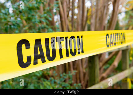 Close-up on yellow Caution tape as safety concept - Stock Image