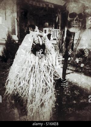 Boy in scary tribal Halloween costume - Stock Image