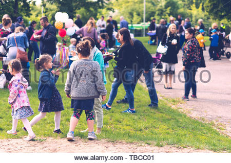 Fathers and mothers with their children at a - Stock Image