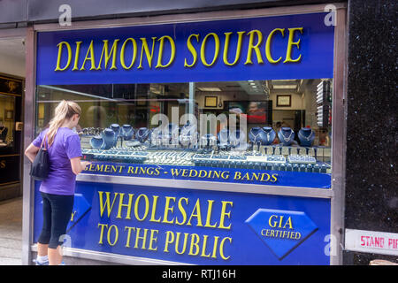 Woman looking a Diamond shop window display in  29 W 47th St, Manhattan, New York, USA - Stock Image