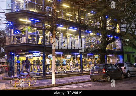 Fitness center in Niteroi, Rio de Janeiro State, Brazil - Marketing strategy - clients displayed to the public as they were ina showcase. - Stock Image