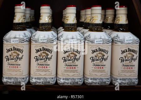 A shelf full of Jack Daniel's Winter Jack Tennessee Cider for sale in a liquor store. - Stock Image