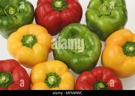 Green, yellow and red peppers. White background. Studio shot.       Ref: CRB538_103609_0036  COMPULSORY CREDIT: Martin Harvey / Photoshot - Stock Image