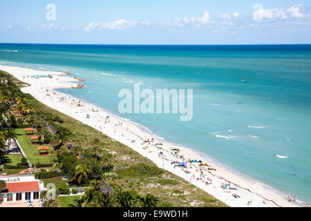 Aerial view of sunbathers, swimmers, surf and cabanas along South Beach, Miami Beach, Florida, USA. - Stock Image