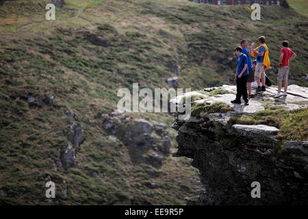 Tintagel Castle is a medieval fortification on the peninsula of Tintagel Island next to Tintagel village in Cornwall - Stock Image