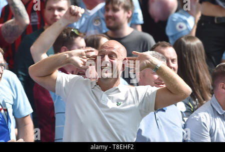 City fans celebrate their second goal during the Premier League match between Brighton & Hove Albion and Manchester City  at the American Express Community Stadium 12 May 2019 Editorial use only. No merchandising. For Football images FA and Premier League restrictions apply inc. no internet/mobile usage without FAPL license - for details contact Football Dataco - Stock Image