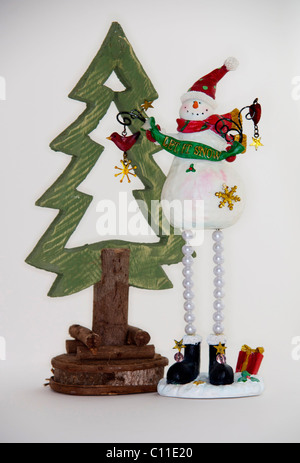 Christmas,seasonal,decoration,snowman,frosty,tree - Stock Image