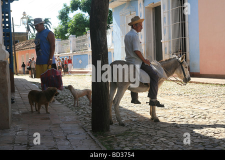 Cuba Trinidad Man on donkey in cobbled colonial street Photo CUBA0932 Copyright Christopher P Baker - Stock Image