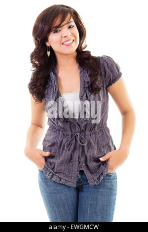 Stock image of young woman casually standing, isolated on white background - Stock Image