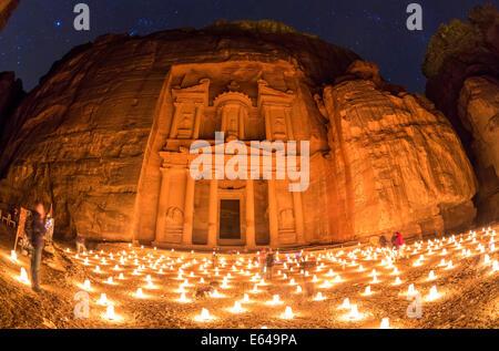 The Treasury, (El Khazneh), at night lit by candles, Petra, Jordan - Stock Image
