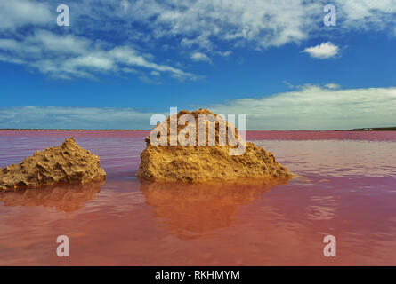 Beguiling and surprising Pink Lake in Western Australia is a photographic attraction.  Lagoon color is due to natural bacteria in high saline water. - Stock Image