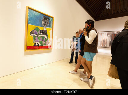 Picasso Museum Malaga - people looking at the painting 'Jacqueline seated, Paris 8.10.54', Museo Picasso malaga, Spain - Stock Image