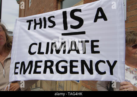 Activists from the Climate Change group Extinction Rebellion hold a banner saying ÒThis is A Climate EmergencyÓ  during a demo outside Derby City Council house on 22/05/2019 - Stock Image