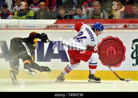 Karlovy Vary, Czech Republic. 18th Apr, 2019. Tim Wohlgemuth of Germany, left, and Petr Zamorsky of Czech Republic in action during the Euro Hockey Challenge match Czech Republic vs Germany in Karlovy Vary, Czech Republic, April 18, 2019. Credit: Slavomir Kubes/CTK Photo/Alamy Live News - Stock Image