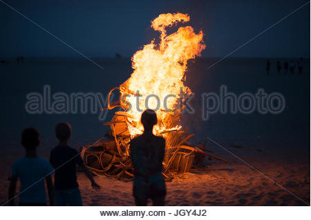Silhouette against bonfire - Stock Image