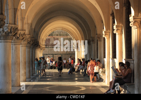 Colonnaded arcade of Palazzo Ducale (Doge's Palace), San Marco, Venice Italy - Stock Image