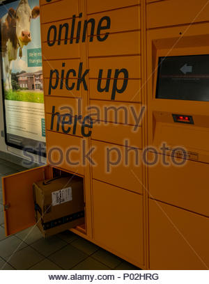 A package available for collection from the Amazon Lockers in Fleet, Hampshire, UK - Stock Image
